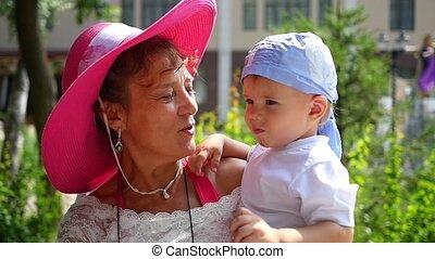 Grandma kissing grandson in slowmotion