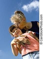 Grandma kissing her