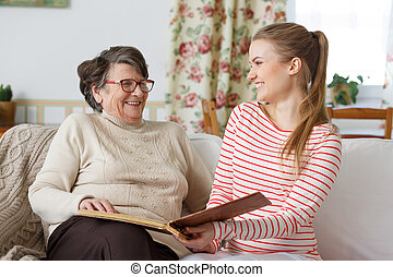 Grandma laughing with her granddaughter - Happy grandma...