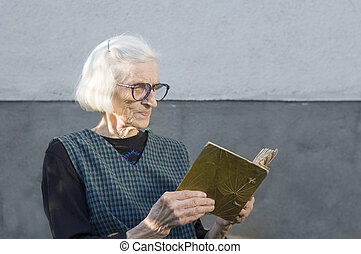 Grandma looking at family photo album
