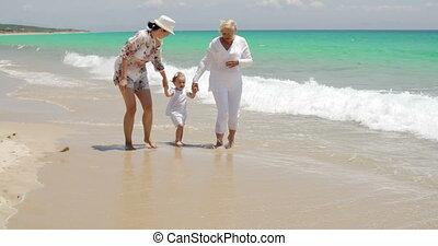 Grandma Mom and Little Girl Walking at the Beach - Grandma...