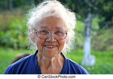 Grandma - Old women smiling and looking at photographer