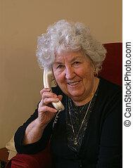 Grandma on telephone - elderly lady making a telephone call...