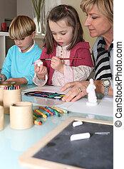 Grandma painting with grandchildren