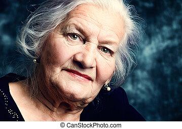 grandma - Portrait of a beautiful smiling senior woman.