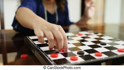 Grandma Playing Checkers Board Game With Granddaughter At...