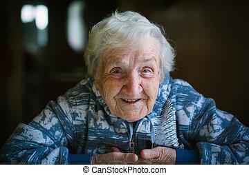 Grandma. Portrait of a happy elderly woman close-up.