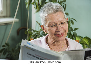 Grandma reading some newspaper articles