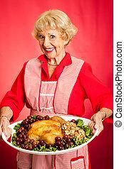 Grandma Serves Holiday Dinner - Pretty grandmother serving...