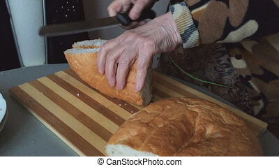 Grandma sliced bread in the kitchen
