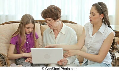 Grandma using laptop - Charming senior lady using laptop...