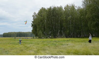 Grandma with grandchild flying kite - Grandmother and little...