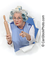 grandma with hair curlers threatening someone with rolling pin