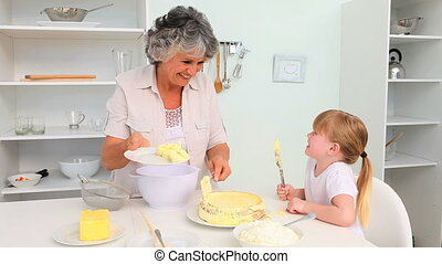 grandmo, elle, petite fille, cuisson