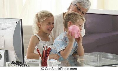 Grandmother and children saving money in a piggybank