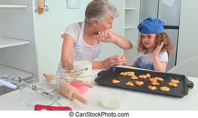 Grandmother and grand daughter proud of what they cooked