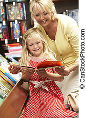 Grandmother and grandaughter in bookshop
