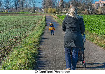 Grandmother and grandchild go for a walk