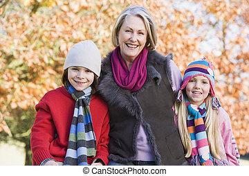 Grandmother and grandchildren on walk