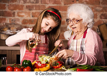 Grandmother and granddaughter cooking together