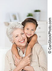 Grandmother and granddaughter - Happy smiling affectionate...