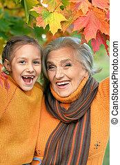 Grandmother and granddaughter having fun