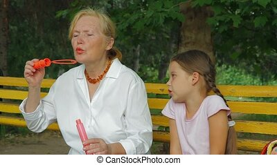 Grandmother And Granddaughter On A Bench