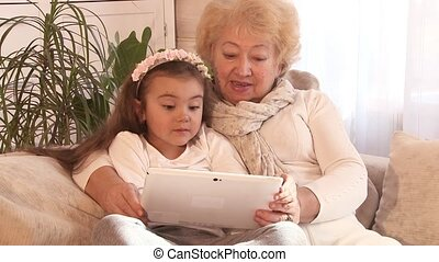 Grandmother and granddaughter using