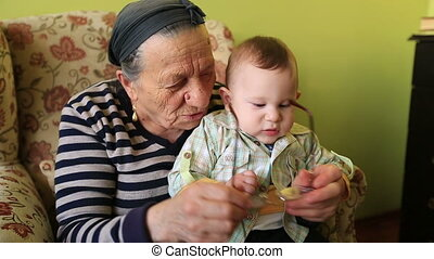 grandmother and grandson - grandmother playing to grandson