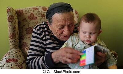 grandmother and grandson - grandmother teaching to grandson