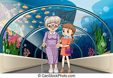 Grandmother and kid at aquarium