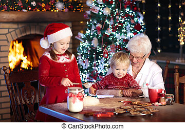 Grandmother and kids bake Christmas cookies. - Grandmother...