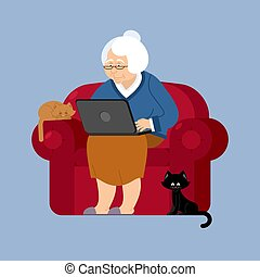 Grandmother and laptop an armchair. old woman and pc. grandma and cat. Elderly woman and computer