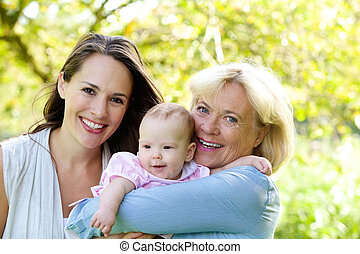 Grandmother and mother smiling with baby