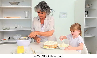 Grandmother baking with her granddaughter