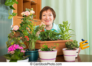Grandmother botany with flowers at home