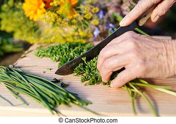 Grandmother chopping fresh parsley - Hands of an elderly...
