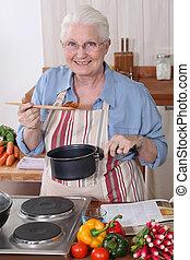 Grandmother cooking.