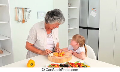 Grandmother cooking with her grandd