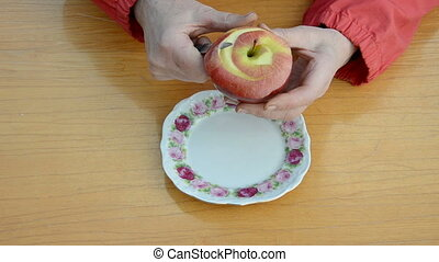 grandmother hands peeling apple