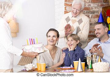 Grandmother holding birthday cake