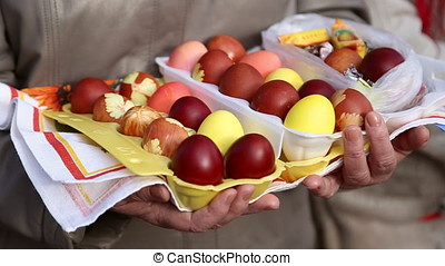 Grandmother holds the easter eggs