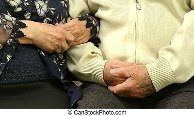 Grandmother holds the hand of the grandfather