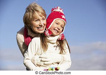 Grandmother Hugging Her Granddaughter
