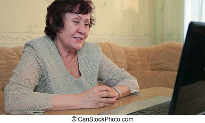 Grandmother in a video conference - Smiling grandmother in a...