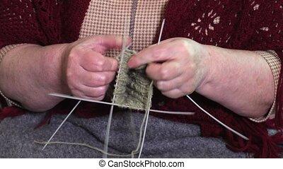 Grandmother knitting close up