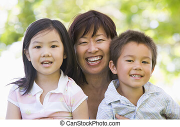 Grandmother laughing with grandchildren.