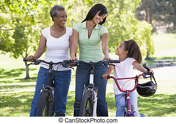 Grandmother mother and granddaughter bike riding.