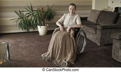 Grandmother on a wheelchair in the room