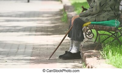 grandmother pensioner homeless poor disabled with crutch...